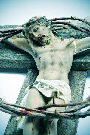 crucify: a representation of Jesus Christ in the Holy Cross and the crown of thorns
