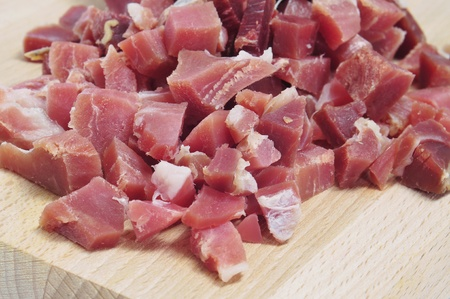 closeup of a pile of chopped spanish serrano ham photo