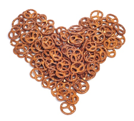 pretzels: a pile of pretzels forming a heart on a white background