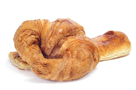closeup of a croissant and a slice of coca amb sucre on a white background photo