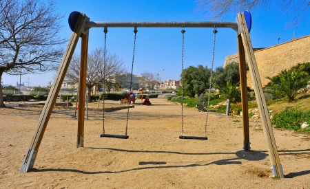 a swing in an outdoors playground photo
