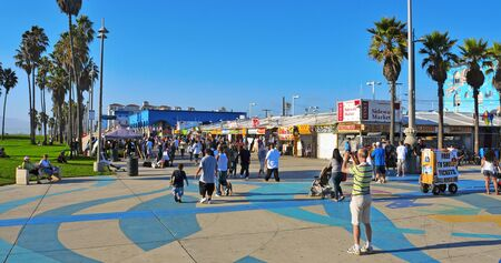 Venice, USA - October 17, 2011: Ocean Front Walk of Venice Beach in Venice, USA. This boardwalk is 2.5 kilometer long and full of colorful shops and food stalls