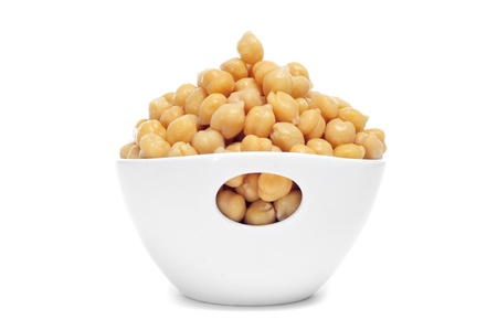 chickpeas: a bowl with boiled chickpeas on a white background