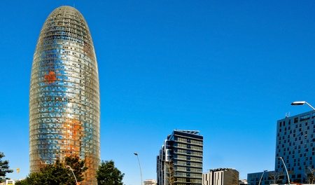Barcelona, Spain - January 22, 2011: Torre Agbar and Technological District in Barcelona, Spain. The 38-storey tower, a landmark in the city, was designed by famous architect Jean Nouvel