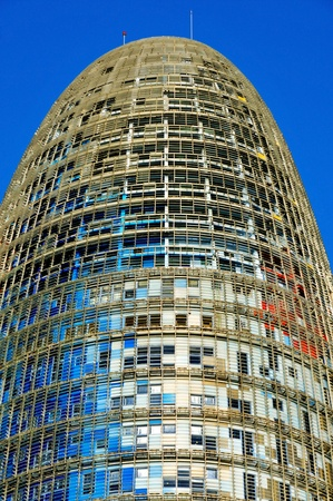 Barcelona, Spain - January 22, 2011: Torre Agbar in Barcelona, Spain. The 38-storey tower, placed in the Technological District of the city, was designed by famous architect Jean Nouvel