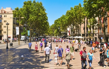 ramblas: Barcelona, Spain - August 16, 2011: La Rambla in Barcelona, Spain. Thousands of people walk daily by this popular pedestrian mall 1.2 kilometer-long