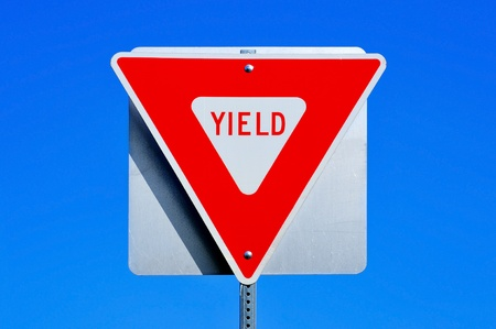 yield sign: a yield traffic sign in a road