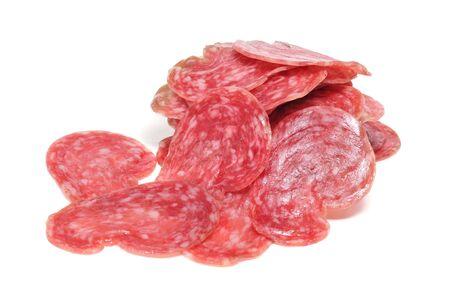 llonganissa: slices of fuet, spanish salami, on a white background Stock Photo
