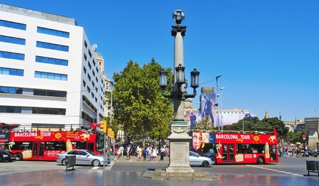 Barcelona, Spain - August 16, 2011: Junction of Rambla de Catalunya and Plaza de Catalunya in Barcelona, Spain. Some of the most important streets meet at Plaza Catalunya, the city center Stock Photo - 12445127
