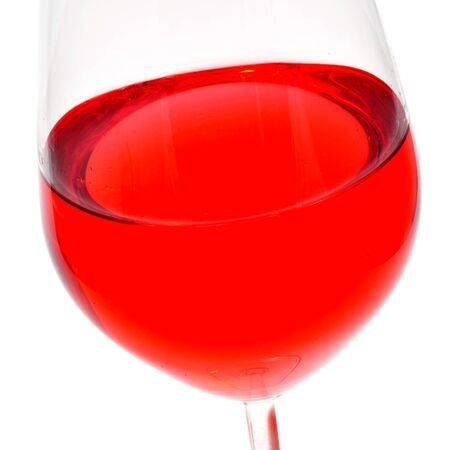 thirstiness: closeup of a glass with red wine on a white background Stock Photo