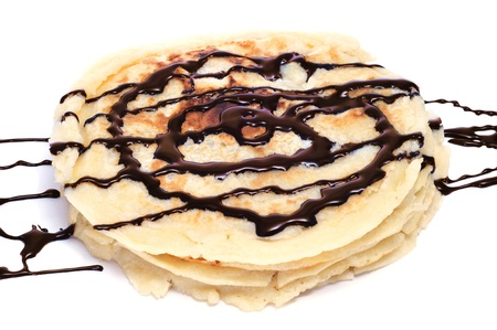chocolate syrup: some pancakes with chocolate syrup on a white background Stock Photo