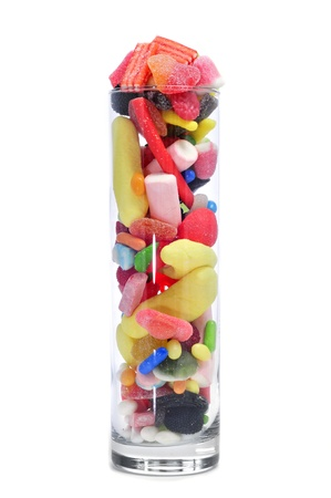 a glass jar full of candies on a white background photo