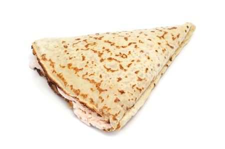 french roll: a stuffed crepe on a white background