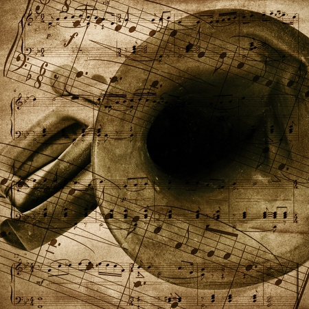 vintage-style background with an old bugle and musical score photo