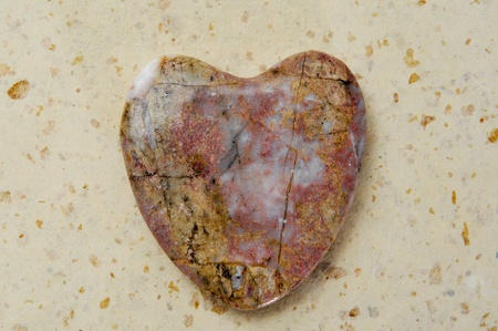 heart-shaped stone on a patterned background photo
