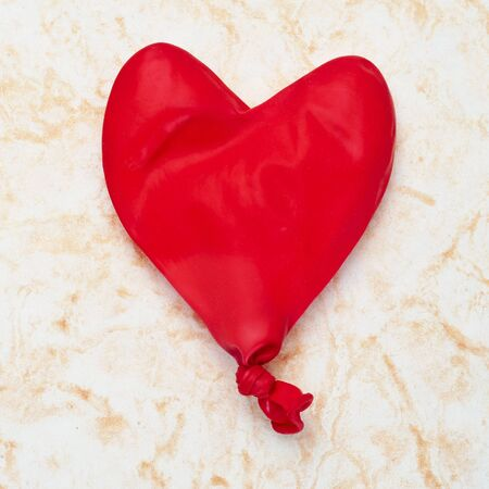 heart-shaped balloon on a marbled background Stock Photo - 12553753