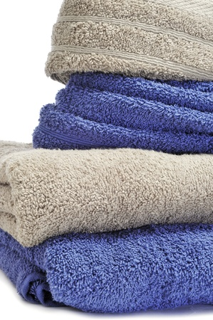 terry: closeup of a pile of towels on a white background Stock Photo