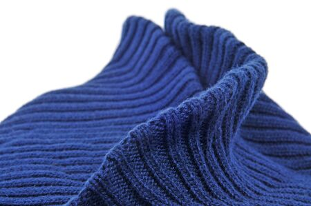 closeup of a blue sweater on a white background photo