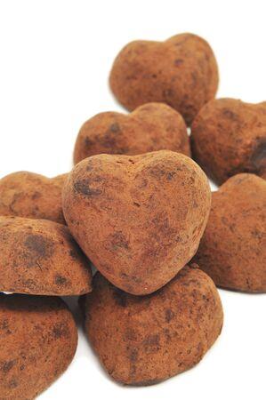 bon: chocolate heart-shaped bonbons on a white background