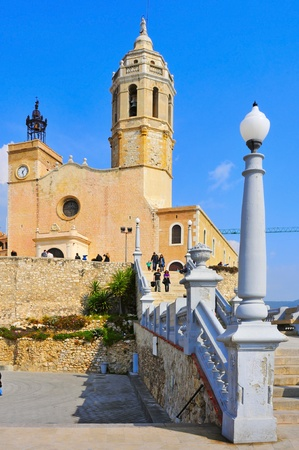 garraf: Sitges, Spain - March 3, 2012: Facade of Church of Sant Bartomeu i Santa Tecla in Sitges, Spain. The 17th century church next to the sea is an iconic building of the gay-friendly city Editorial
