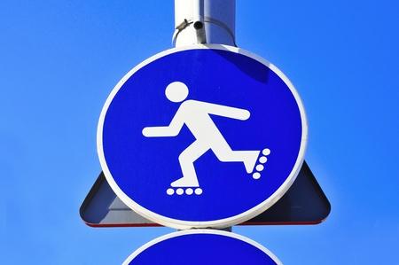 inline skater: no skating sign over the blue sky