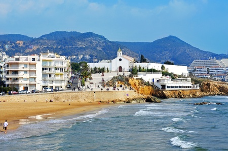 garraf: Sitges, Spain - March 3, 2012: View of Sant Sebastia Beach in Sitges, Spain. This urban beach, named after the Sant Sebastia Cemetery next to this, is 190 meters long