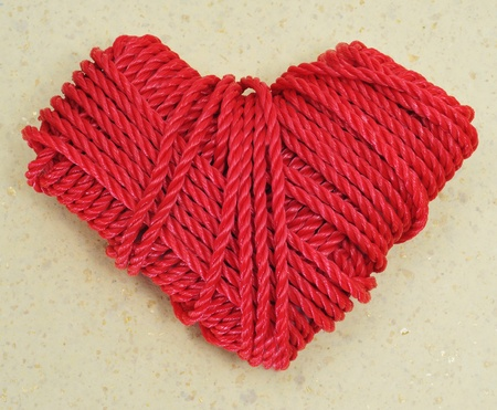marbling: heart-shaped coil of red rope on a marbling background