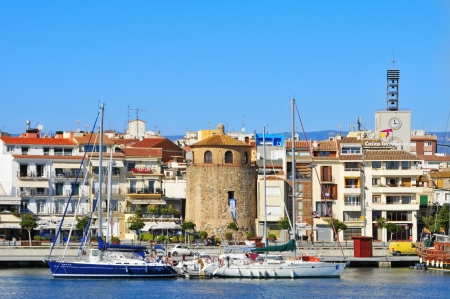 defensive: Cambrils, Spain - February 25, 2011: Panoramic view of Cambrils (Spain) coastline with its iconic tower. This defensive tower houses nowadays a museum Editorial