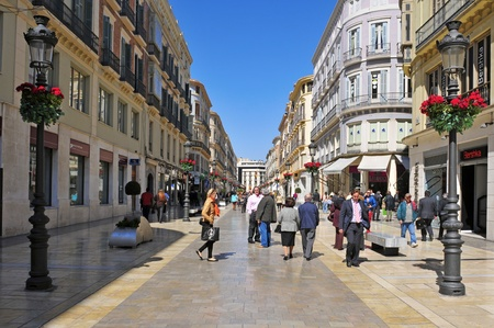 malaga: Malaga, Spain - March 12, 2012: Calle Larios in Malaga, Spain. This 300 meters long street is the main commercial street of the city and the fifth most expensive shopping street in Spain