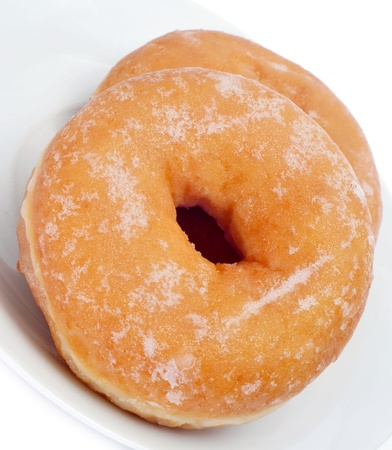 a plate with a pair of donuts  on a white background photo
