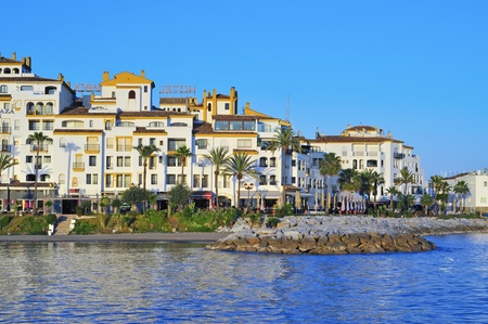 condominium complex: Marbella, Spain, March 13, 2012: Puerto Banus in Marbella, Spain. Puerto Banus is visited annually by nearly 5 million people and its marina has berths for 915 boats Editorial