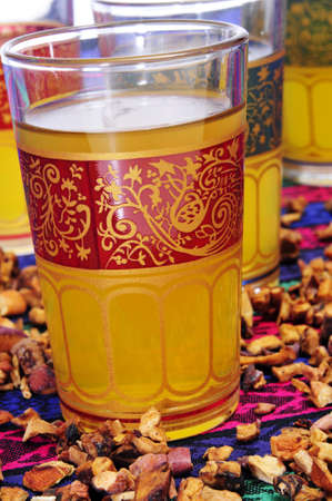 ornamented: closeup of some ornamented glasses with tea Stock Photo