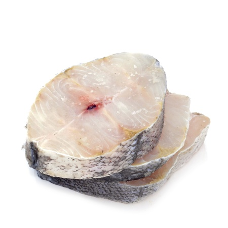 some slices of raw hake on a white background photo
