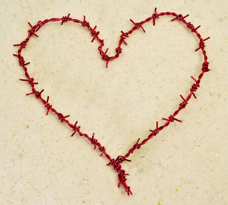 heart-shaped barbed wire on a marbled; background photo