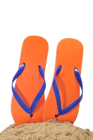 flip: a pair of flip-flops on the sand on a white background Stock Photo