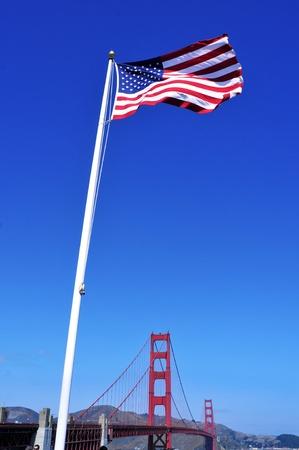 US flag and Golden Gate Bridge in San Francisco, United States photo