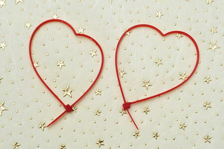 heart-shaped zip ties on a patterned background Stock Photo - 12893918