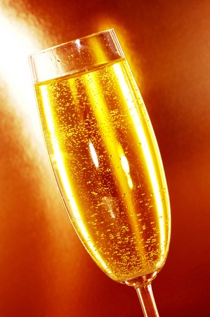a glass of champagne on a orange background photo