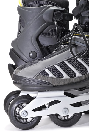 closeup of a pair of inline skates on a white background photo