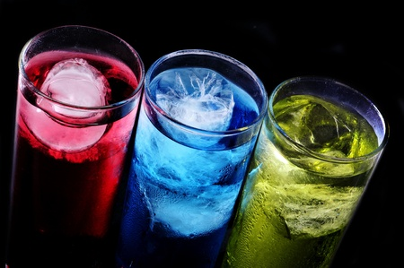 thirstiness: some glasses with cocktails of different colors on a black background Stock Photo
