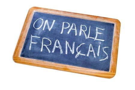 spoken: sentence french is spoken written in french on a chalkboard