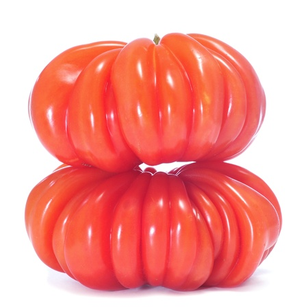 heirloom: a pair of wrinkled zapotec heirloom tomatoes on a white background Stock Photo