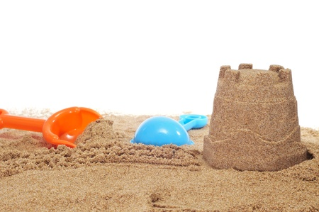 sandcastle and beach shovels on a white background photo