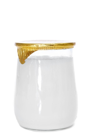 a yogurt in a glass jar on a white background photo