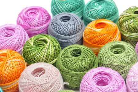 haberdashery: a pile of crochet thread of different colors on a white background Stock Photo
