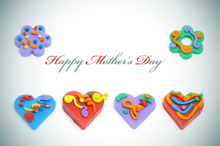 happy mothers day written in a faded background with colorful ornaments as hearts and flowers