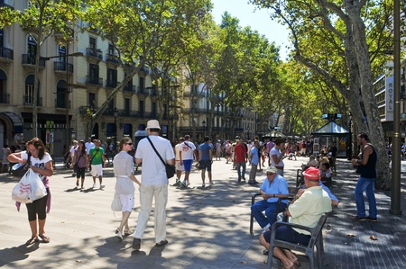 Barcelona, Spain - August 16, 2011: La Rambla in Barcelona, Spain. Thousands of people walk daily by this popular pedestrian mall 1.2 kilometer-long