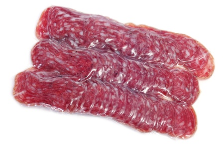 llonganissa: vacuum-packed slices of fuet, spanish salami, on a white background