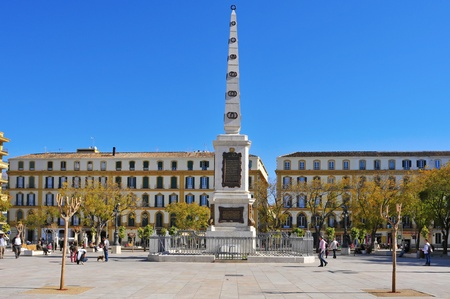 Malaga, Spain - March 13, 2012: Plaza de la Merced in Malaga, Spain. In this square, one of the main squares in the center of the city, there is the obelisk in honor of General Torrijos Editorial