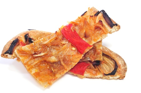 some slices of coca de recapte, a typical catalan dish, on a white background photo